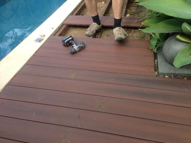 Rosewood colour composite decking around a pool for Best timber to use for decking around a pool
